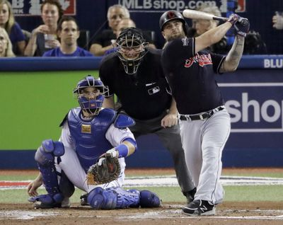 Cleveland's Mike Napoli watches his solo home leave the park in the fourth inning during Game 3 of baseball's American League Championship Series against the Toronto Blue Jays in Toronto, Monday, Oct. 17, 2016. Cleveland won 4-2. (Charlie Riedel / Associated Press)