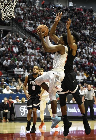 Gonzaga forward Rui Hachimura sizes up San Diego State guard Devin Watson before blocking his shot in the second half Thursday in San Diego. (DENIS POROY / AP)