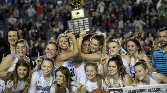 Central Valley girls hoist the State 4A championship trophy on Saturday, March 7, 2020. (Patrick Hagerty / For The Spokesman-Review)