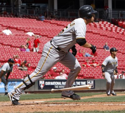 The Pirates' Jason Jaramillo – and few others – watch his RBI single Monday in Game 1 of a doubleheader. (Associated Press / The Spokesman-Review)