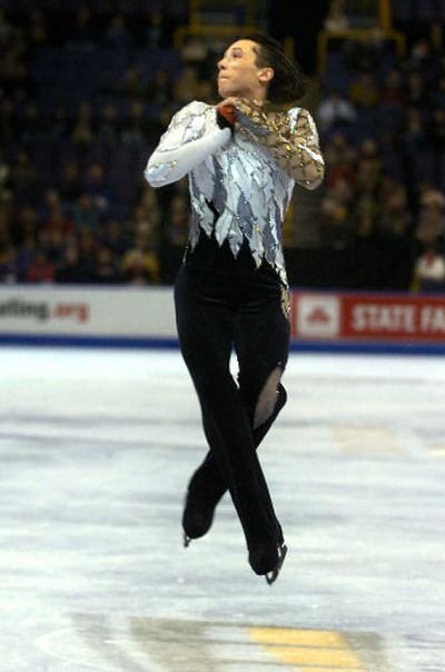Johnny Weir performs a triple jump Thursday during the men's short program at the U.S. Figure Skating Championships.   (Colin Mulvany / The Spokesman-Review)