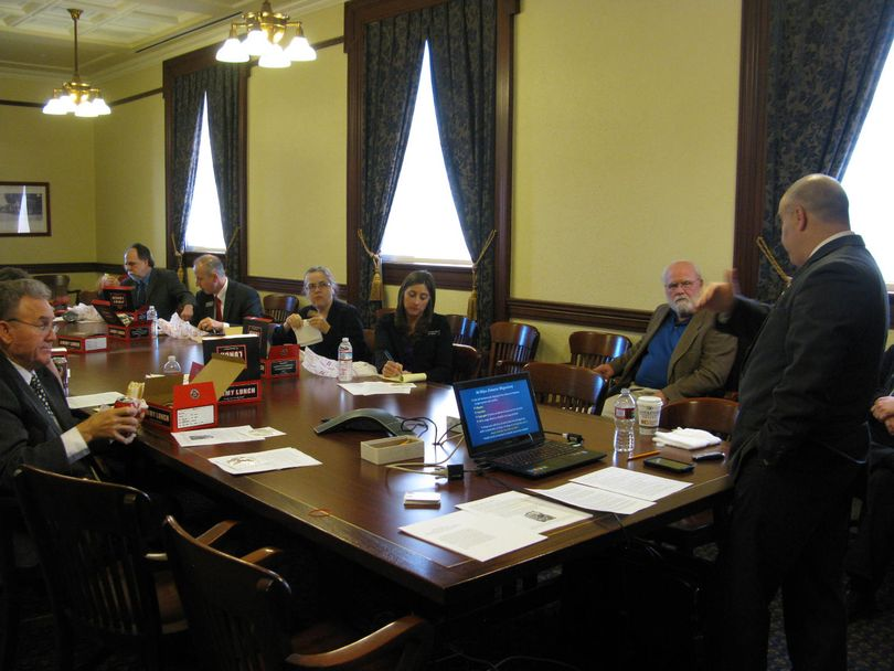 Thirteen Idaho lawmakers listen to a luncheon talk at the Statehouse on Thursday from the Rev. Shahram Hadian (Betsy Russell)