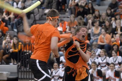 "Post Falls  senior Brady Ryan yells as he pummels sophomore Alex Carey during the ""noodle"" fights during the Spirit Competition  before the game between Post Falls and Lakeland. (J. Rayniak / The Spokesman-Review)"