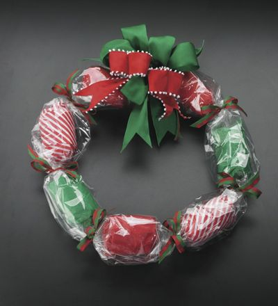 A holiday wreath made of individually wrapped gifts.