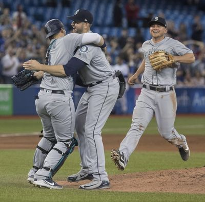 Seattle Mariners starting pitcher James Paxton, center, celebrates with teammates after throwing a no-hitter against the Toronto Blue Jays in a baseball game Tuesday, May 8, 2018, in Toronto. (Fred Thornhill / Canadian Press via AP)