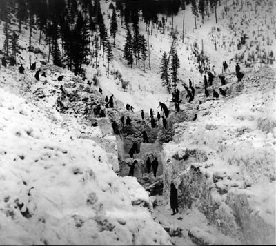 Residents of Mace, Idaho, search for victims of a massive avalanche in Burke Canyon in late February 1910. It was one of the most devastating slides in the history of the North Idaho mining area. (The Spokesman-Review photo archive / SR)