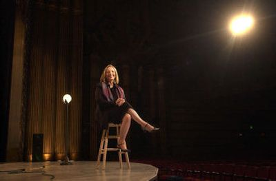 The Spokane Symphony's new executive director, Brenda Nienhouse, takes a seat on the stage of the Fox Theater, the eventual home of the orchestra.   (Brian Plonka / The Spokesman-Review)