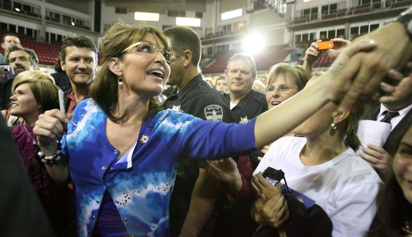 Sarah Palin greets people at the Qwest Arena in Boise, Idaho on Friday May 21, 2010 after giving a speech for Republican Vaughn Ward who is running for a seat in congress. Former Alaska Gov. Sarah Palin had to quickly buy a new outfit before a rally in Idaho on Friday because her luggage got lost. Republican congressional hopeful Vaughn Ward introduced Palin before about 1,500 people and said she and her family arrived on time in Boise but their bags did not. (Ashley Smith / Times-news)