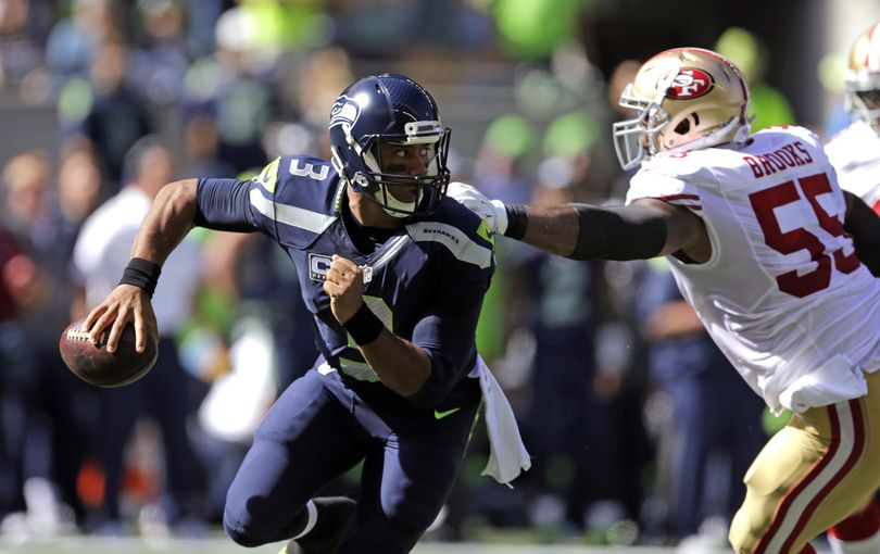 Seattle Seahawks quarterback Russell Wilson has recovered quickly from another injury and will start on Sunday in New York against the Jets. (John Froschauer / Associated Press)