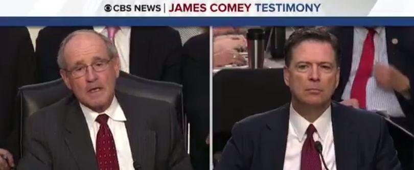 Idaho Sen. Jim Risch, left, questions former FBI Director James Comey, right (Screen shot from CBS News coverage)