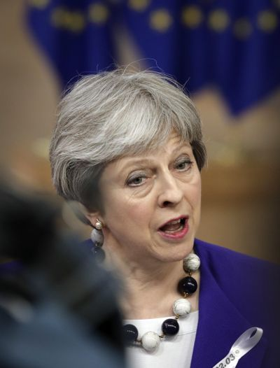 British Prime Minister Theresa May speaks with the media as she arrives for an EU summit at the Europa building in Brussels on Thursday, March 22, 2018. (Olivier Matthys / Associated Press)