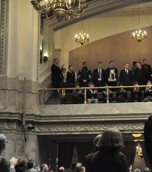 Members of  the EWU Eagles football team stand for applause from the House of Representatives and members of the gallery. (Jim Camden/staff writer)