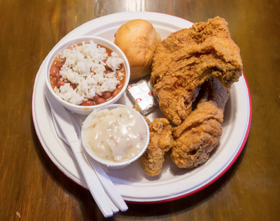 A three-piece chicken dinner at Chicken-N-More includes two sides. In this 2017 photo, they are red beans and rice and mashed potatoes and gravy with a roll. Chicken-N-More is at 414 ½ W. Sprague Ave. in downtown Spokane.  (Jesse Tinsley/The Spokesman-Review)