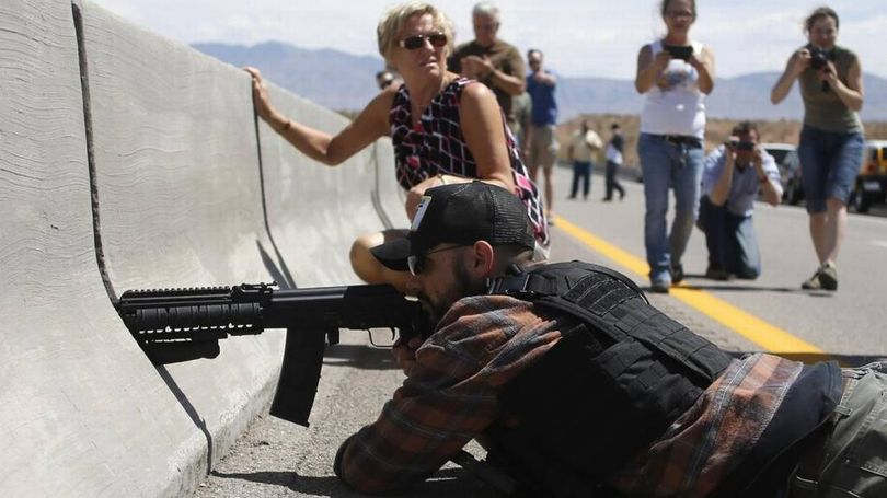Protester Eric Parker aims his weapon in April 2014 from a bridge next to the Bureau of Land Management's base camp where seized cattle, belonging to rancher Cliven Bundy, were held near Bunkerville, Nev. (Reuters / Jim Urquhart )