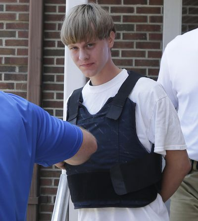 In this June 18 file photo, Dylann Storm Roof is escorted from the Sheby Police Department in Shelby, N.C. (Chuck Burton / Associated Press)