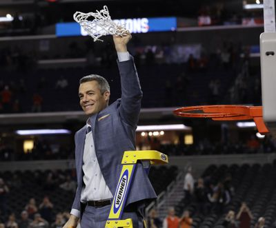Virginia head coach Tony Bennett celebrates after cutting down the net following the championship game against Texas Tech in the Final Four NCAA college basketball tournament, Monday, April 8, 2019, in Minneapolis. Virginia won 85-77 in overtime. (AP Photo/David J. Phillip) ORG XMIT: FF570 (David J. Phillip / AP)