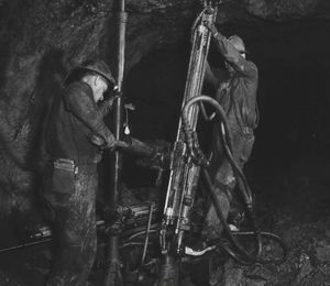 Miners setting up Rock Drills in The Bunker Hill Company Mine at Kellogg.  (1959 SR file photo)