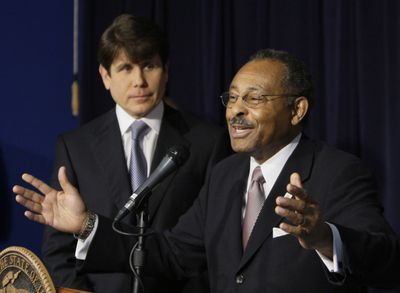 Former Illinois Attorney General Roland Burris addresses the media in Chicago on Dec. 30 after being appointed by  Gov. Rod Blagojevich, left, to fill President Barack Obama's U.S. Senate seat.  (Associated Press / The Spokesman-Review)