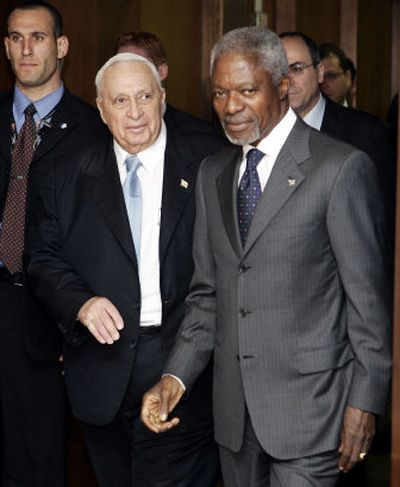 The prime minister of Israel, Ariel Sharon, left, arrives for a meeting Sunday with U.N. Secretary-General Kofi Annan at U.N. headquarters in New York.   (Associated Press / The Spokesman-Review)