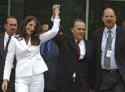 Richard Scrushy and wife Leslie raise their hands  after Richard Scrushy was acquitted of all charges.   (Associated Press / The Spokesman-Review)