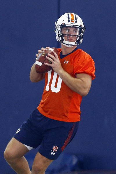 In this Friday, Aug. 2, 2019 photo, Auburn quarterback Bo Nix throws a pass during Auburn's first practice in Auburn, Ala. Freshman Bo Nix will be Auburn's starting quarterback in the season opener against Oregon. (Butch Dill / Associated Press)