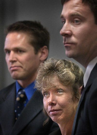 Shannon Sullivan is flanked by her attorneys Brant Stevens, left, and Mark Hodgson at Tuesday's press conference.   (Brian Plonka / The Spokesman-Review)