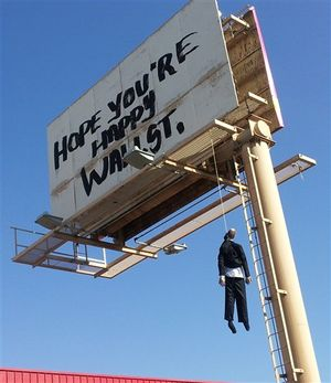 This image provided by KVVU-TV shows a billboard with a mannequin dangling from a hangman's noose near The Strip in Las Vegas. Authorities said calls began coming in early Wednesday Aug. 8, 2012, from drivers worried the dummy along Interstate 15 near was a real person. A Nevada Highway Patrol spokesman said the sign is a publicity stunt done in bad taste. A woman who answered the phone at Lamar Advertising Co. says the sign was not authorized and was being removed. (AP Photo/KVVU, Peter Dawson) ((AP Photo/KVVU, Peter Dawson))