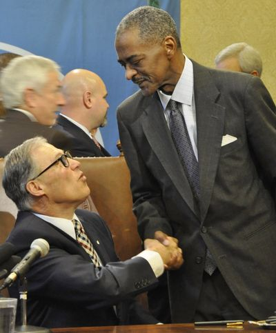 Gov. Jay Inslee congratulates WSU President Elson Floyd after signing a bill that gives WSU authority to start its own medical school in Spokane. (Jim Camden)