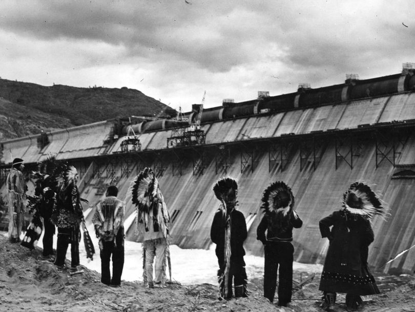 This is a picture taken by William S. Russell for the Bureau of Reclamation in 1941 of the traditional Chiefs of the Colville Indian Reservation. This is some of the final steps to completing the Grand Coulee Dam. These chiefs gathered before this structure to witness the finishing of the dam. The photo is held at the Confederated Tribes of the Colville Reservation History and Archeology Program. It is also held at the WSU and University of Washington photo archives.