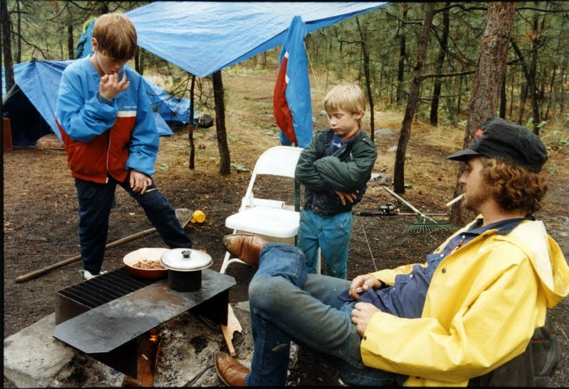 A family coops over a campfire at a campground in Riverside State Park. (File)