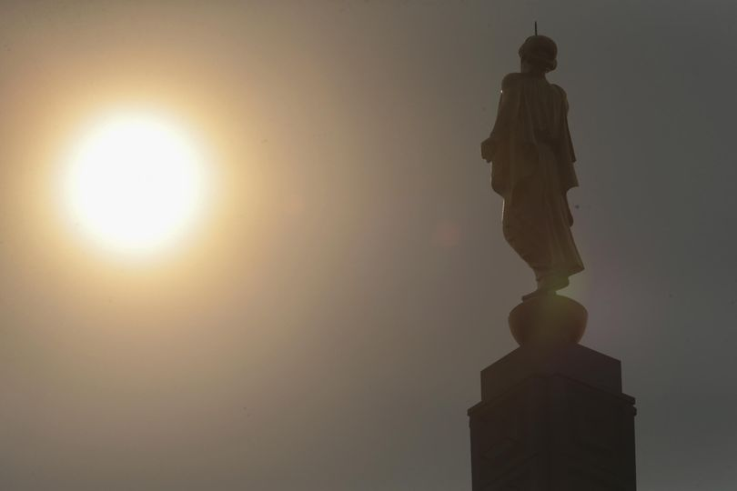 The statue of the Angel Moroni is seen under smoky skies in Idaho Falls, Idaho, Tuesday, Sept. 5, 2017. The heavy smoke that had set in over Idaho Falls from fires across the state has somewhat abated, thanks to the past week's rainfall and cooler temperatures. (John Roark / AP)