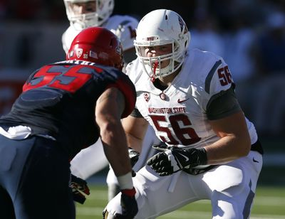 Washington State offensive lineman Joe Dahl (56), a graduate of University High, played 692 snaps this season and gave up just three sacks.