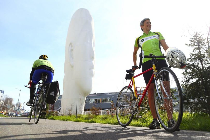 Catherine Hennings, right, board president of Cascade Bicycle Club, pauses on the bicycle trail at Seattle's Myrtle Edwards Park, part of an urban loop she recommends. (John Lok/The Seattle Times / Associated Press)