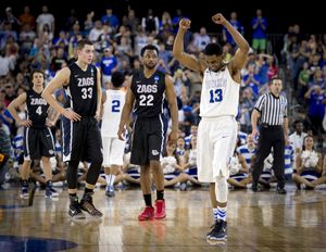 Gonzaga forward Kyle Wiltjer (33) and Gonzaga guard Byron Wesley (22) watch time run out and Duke guard Matt Jones (13) celebrate the Blue Devils 66-52 win over the Bulldogs , Sunday, March 29, 2015, in Houston, Texas. (The Spokesman-Review)