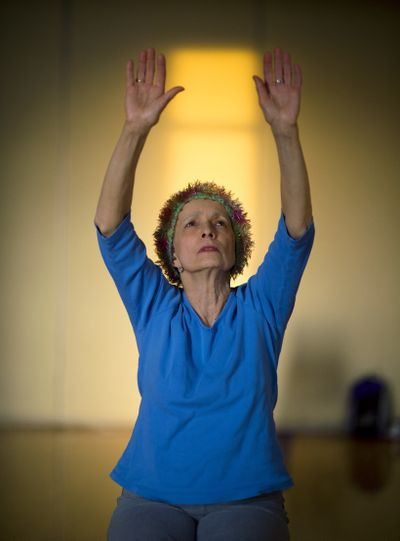 Cancer survivor Joan Syverson stretches in a yoga class at the downtown YMCA as part of Livestrong at the YMCA, a fitness and community-building program for people with cancer or recovering from cancer. (Colin Mulvany)