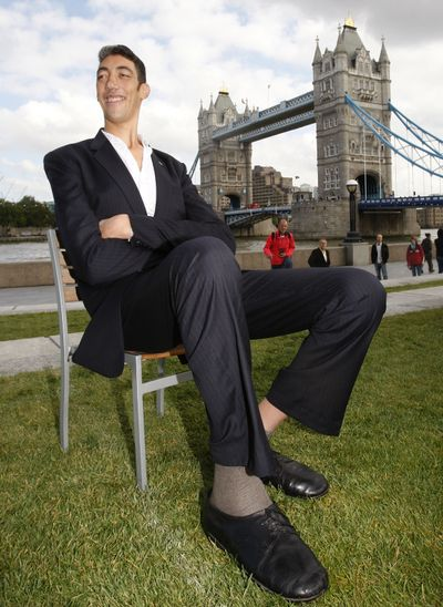 Sultan Kosen, from Turkey, sits in front of Tower Bridge in London.  (Associated Press / The Spokesman-Review)