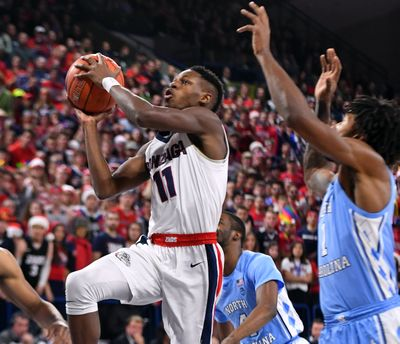 Gonzaga guard Joel Ayayi drives inside against North Carolina defenders during a Dec. 2019 game at the McCarthey Athletic Center.  (Colin Mulvany / The Spokesman-Review)