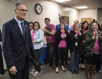 Washington Gov Jay Inslee is greeted as he enters Planned Parenthood of Greater Washington and North Idaho, Friday, Feb. 3, 2017, in Spokane. (Dan Pelle / The Spokesman-Review)