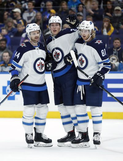 Winnipeg Jets' Patrik Laine, of Finland, is congratulated by Josh Morrissey (44) and Kyle Connor (81) after scoring during the first period of an NHL hockey game against the St. Louis Blues, Saturday, Nov. 24, 2018, in St. Louis. (Jeff Roberson / Associated Press)
