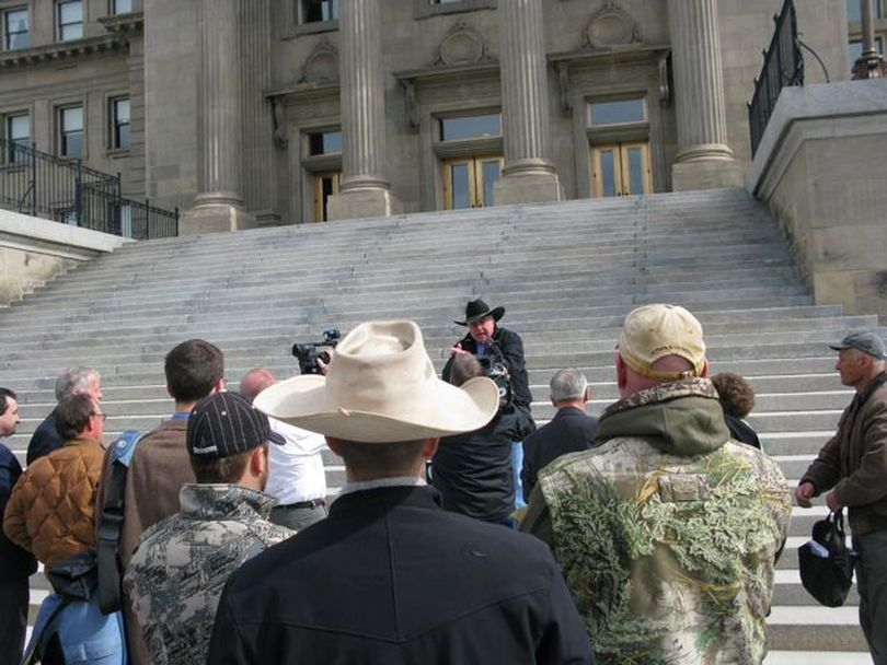 A group of wolf opponents rallies on the Statehouse steps on Wednesday to celebrate House passage a day earlier of HB 343, to declare a disaster emergency in the state due to wolves. (Betsy Russell)