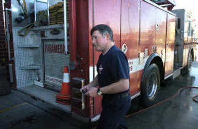 John Gilbert heads to his truck at Spokane's Fire Station 4 to answer a call on Nov. 13.   (CHRISTOPHER ANDERSON / The Spokesman-Review)