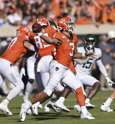 Oklahoma State quarterback Spencer Sanders (3) throws a pass during the first half of an NCAA college football game against Baylor in Stillwater, Okla., Saturday, Oct. 19, 2019. (Brody Schmidt / Associated Press)