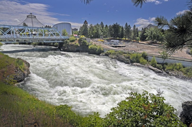 The Spokane River roars through Riverfront Park just below the site of the old YMCA building demolition on Thursday, June 23, 2011. The view from the park across the river has been greatly enhanced since the building was torn down.    (Christopher Anderson)
