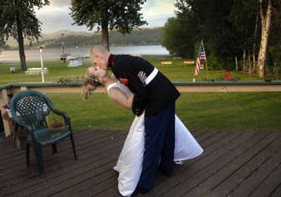 Blissful moment: Lance Cpl. Matt Shipp plants a kiss on his bride, Jessica, after their wedding May 27 in Hauser Lake, Idaho. Matt and Jessica tied the knot during a break from his advanced training in the Marine Corps. Matt called Jessica three days before the wedding to say he had volunteered for early duty in Iraq.  (Brian Plonka / The Spokesman-Review)