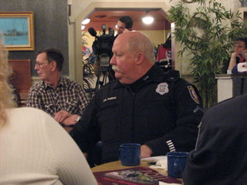 Hillyard neighborhood resource officer Kim Thomas listens at meeting in Hillyard on 15/12/2010 (Pia Hallenberg)