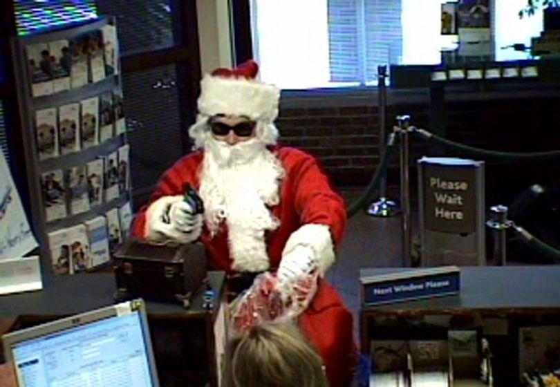 This Tuesday, Dec. 22, 2009 image made from video released by the Metropolitan Nashville Police Department shows a man dressed as Santa robbing the Sun Trust Bank in Nashville, Tenn. (AP Photo/Metropolitan Nashville Police Department) (AP/Metropolitan Nashville Police Department)
