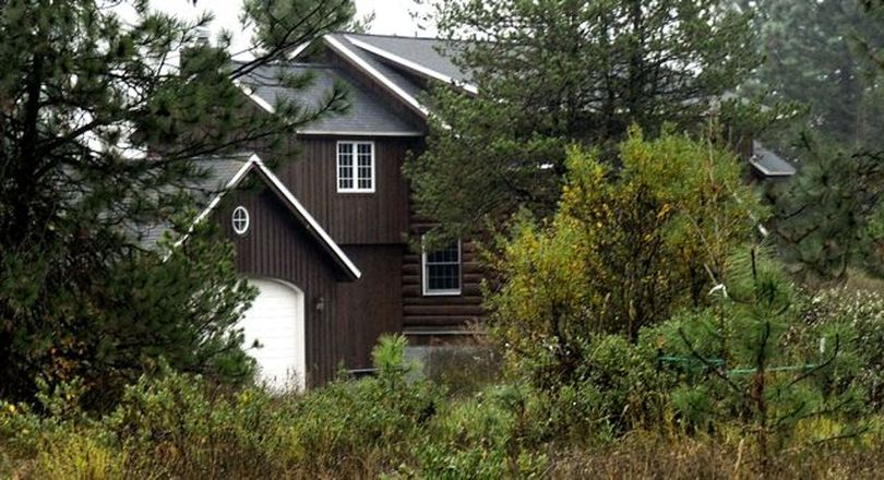 Rep. Phil Hart's Athol home, built in part with logs cut illegally from Idaho school endowment lands (Kathy Plonka)