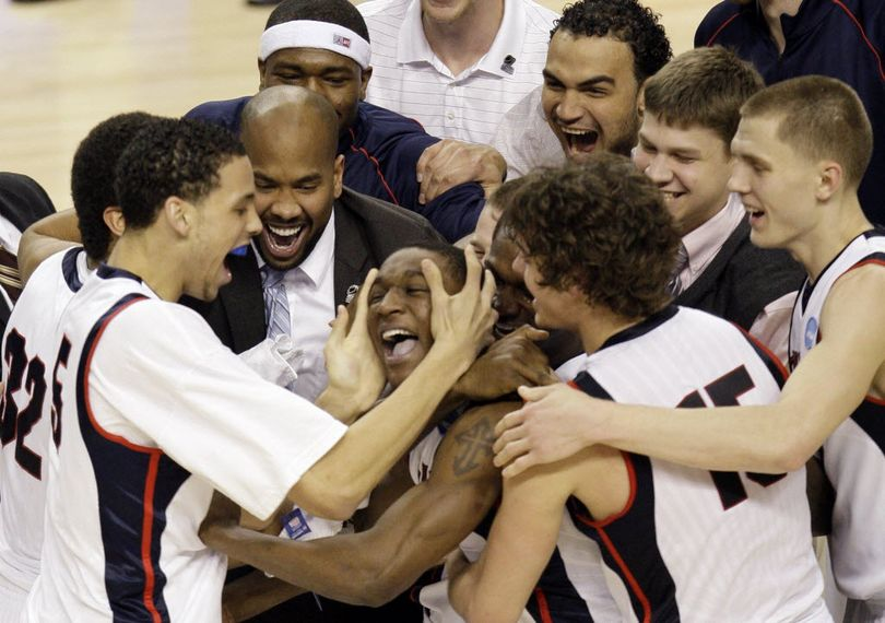 Gonzaga's Demetri Goodson, center, is hugged by teammates after scoring the winning shot against Western Kentucky during the second-round men's NCAA college basketball tournament game Saturday (Associated Press)