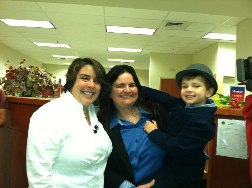 Shelia Robertson and Andrea Altmayer with son Bridger, at the Ada County Courthouse on Wednesday morning for a marriage license (Betsy Russell)