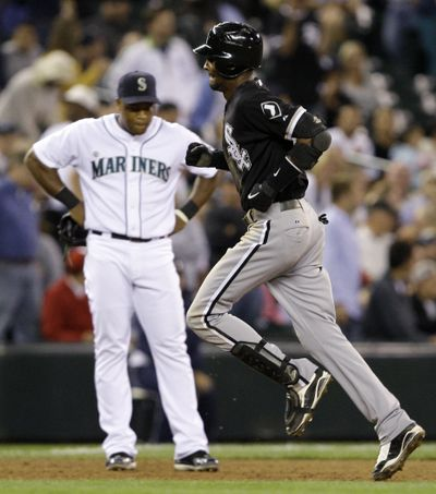 Chicago's Alexei Ramirez rounds the bases after hitting a three-run homer in the ninth. (Associated Press / The Spokesman-Review)